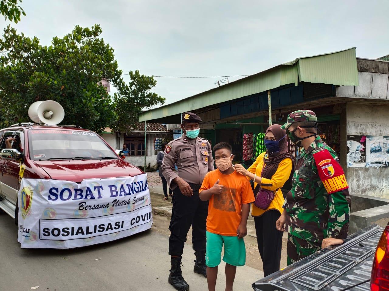 Sosialisasi dan Bagi Masker Aksi Cepat Hadapi Pandemi Virus Corona di Kecamatan Bangilan